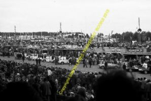 Mercedes 300SLRs and Jaguar D Types at Le Mans prior to start 1955